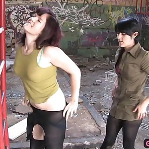 Adorable hairy lesbian fucked with a strapon