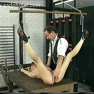 Horny slave get tied to a table gets finger fucked and a rope around her nipples by her master