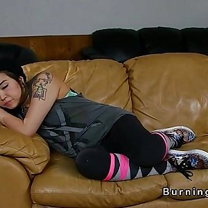 Tattooed Asian babysitter fucked on leather couch