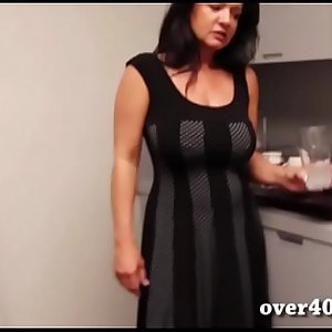 Busty mature strokes dick in the kitchen