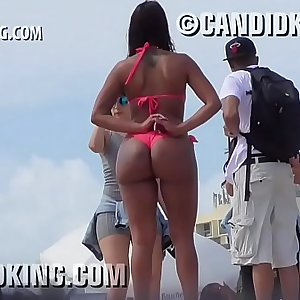 Tan Latina with big butt PAWG in a panty bikini on the beach!