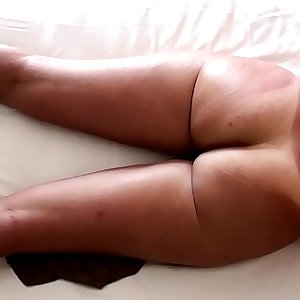 Nude on vacation with her ass tan