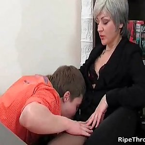 Slutty Mummy gives blowjob to horny youthfull