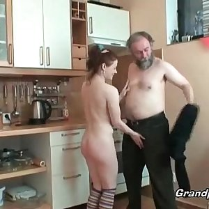 Hot redhead rides cock in kitchen