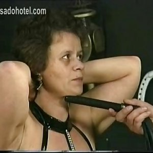 Old hot fat and horny slave got hit with a whip on her back and her master plays with her large tits