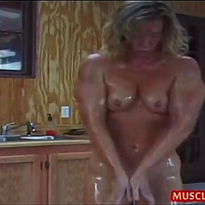 Oiled up Sports Mummy gets enormous clitoris sucked