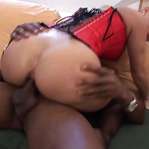 Hot blonde slut Patricia in a corset rails a giant black cock in her taut asshole
