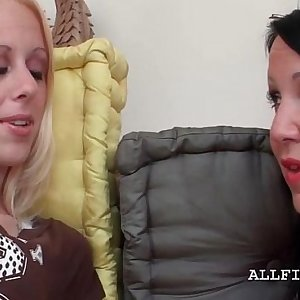 Two excited lesbos tongue kissing in close-up