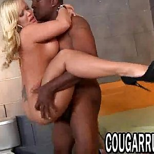 Blonde cougar sucks a big black shaft before fucking