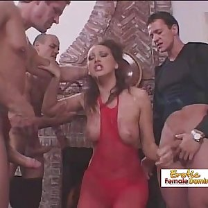 Gorgeous brunette gets fucked by three mild at the same time