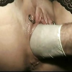 Horny tied slave with her legs spread and pussy pierced is fist fucked by master untill she cums